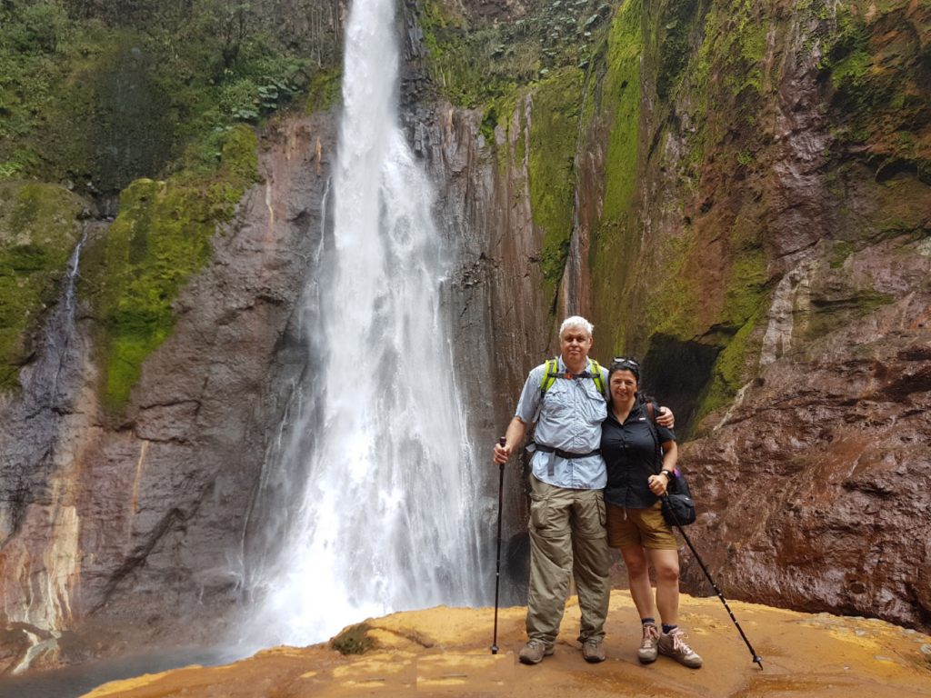 Veronica and Asaf next to the spectacular Toro Waterfall in Costa Rica